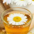Healthy chamomile tea, mortar with daisies — Stock Photo