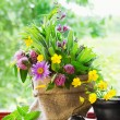 Sack with bouquet of healing herbs and flowers, mortar and pestle on windowsill — Stock Photo