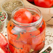 Homemade tomatoes preserves in glass jar. Canned tomatoes. — Stock Photo #10993597