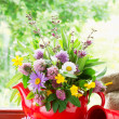 Red teapot with bouquet of healing herbs and flowers on windowsi — Stock Photo