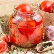 Stock Photo: Homemade tomatoes preserves in glass jar. Canned tomatoes.