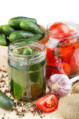 Canned tomatoes and cucumbers, homemade preserved vegetables — Stock Photo