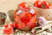 Homemade tomatoes preserves in glass jar. Canned tomatoes. — Stockfoto