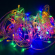 Multicolored electric christmas lights. Decorative festive garla — Stock Photo