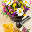 Mortar with healing herbs and flowers, herbal tea on table, alte — Stock Photo