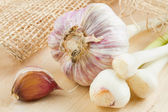 Garlic on wooden board — Stock Photo