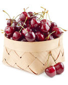 Cherries in basket on white — Stock Photo