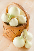 Onions in basket — Stock Photo