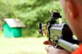 Man shooting a shotgun — Stock Photo