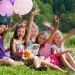 Beautiful girls celebrate birthday outdoors — Stock Photo #11977654