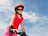 Teenage girl on a bicycle — Stockfoto