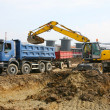 Stock Photo: Digger handled dirt on freight car