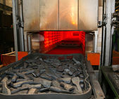 Steel parts and high heat furnace — Stockfoto