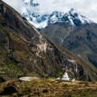 Buddhist stupe or chorten and summits in Himalayas — Stock Photo