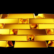 Pure gold: bullions or bars stack isolated — Stock Photo #11786393