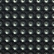 Stock Photo: Sound and stereo: black speakers over leather pattern