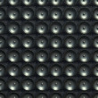 Sound and stereo: black speakers over leather pattern — Stock Photo