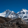 Snowbound mountain peaks and blue sky in Himalayas — Stock Photo