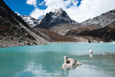 Balance: Pebble stacks and Sacred Lake near Gokyo — Stock Photo