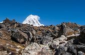 Moraine and Pumori peak in Himalayas — Stock Photo