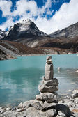 Harmony: Stone stack and Sacred Lake near Gokyo — Stock Photo
