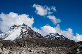 Summit and clouds near Sacred Lake of Gokyo in Himalayas — Stock Photo