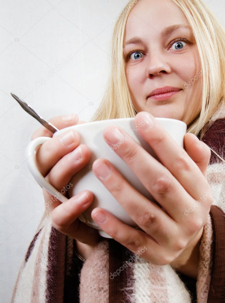 Girl with a cup wrapped in a blanket. white background — Stock Photo #10820825