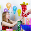 Birthday. The girl accepts gifts - Stock Photo