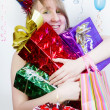 Royalty-Free Stock Photo: Birthday. Happy girl with gifts