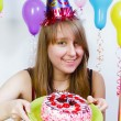 Birthday. A young attractive girl with cake — Stock Photo