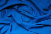 The folds of a bright blue cloth. Abstract Background — Stock Photo