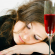 Sleeping girl and a glass of wine — Stock Photo #11357965
