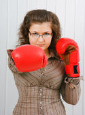 Business woman with boxing gloves — Stock Photo