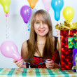 Birthday. Attractive young girl with gifts - Stock Photo