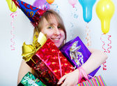 Birthday. happy young girl with gifts — Stock Photo