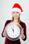 Young attractive girl with a clock — Stock Photo
