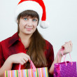 A girl in a Christmas hat — Stock Photo