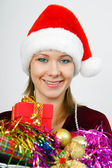 Portrait attractive young woman with Christmas decorations — Stock Photo