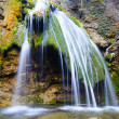 Stock Photo: Flowing waterfall