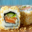 Sushi with salmon and cucumber with sesame seeds — Stock Photo