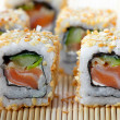 Sushi with salmon and cucumber — Stock Photo