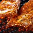 Raw pork ribs on grill — Stock Photo