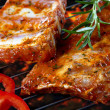 Raw pork ribs on grill - Stock Photo