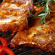 Stock Photo: Raw pork ribs on grill