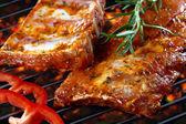 Raw pork ribs on grill — Stock Photo