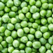 Green peas background — Stock Photo