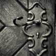 Retro keyhole in old wooden door — Stock Photo