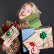 A lovely woman holding a many gift boxes — Stock Photo