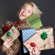 Royalty-Free Stock Photo: A lovely woman holding a many gift boxes