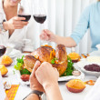 Family members giving thanks to God at festive table — Stock Photo #11932326